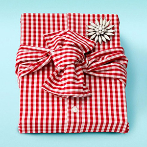 Gift warpped with shirt and brooch, photo