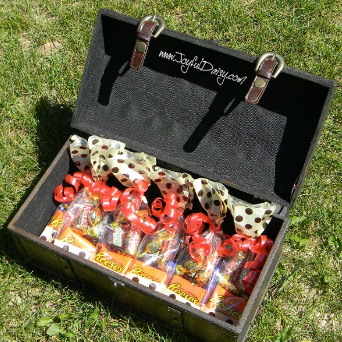 Treasure chest with bags of candy, photo