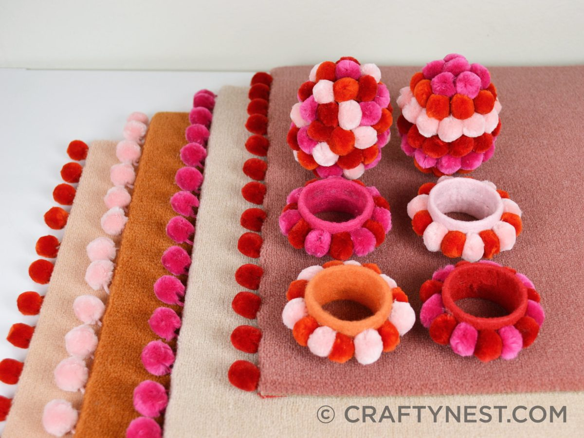 Pom-pom placemats, napkin rings, and Easter eggs, photo