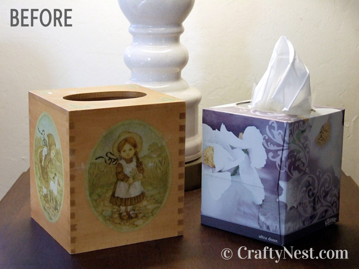 A decoupaged wooden tissue box holder, photo