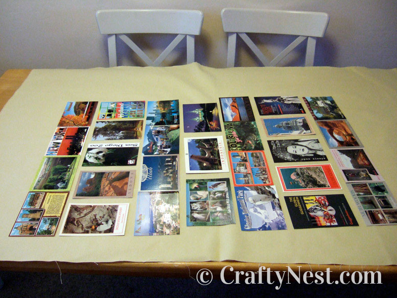 Postcards laid out on the fabric, photo