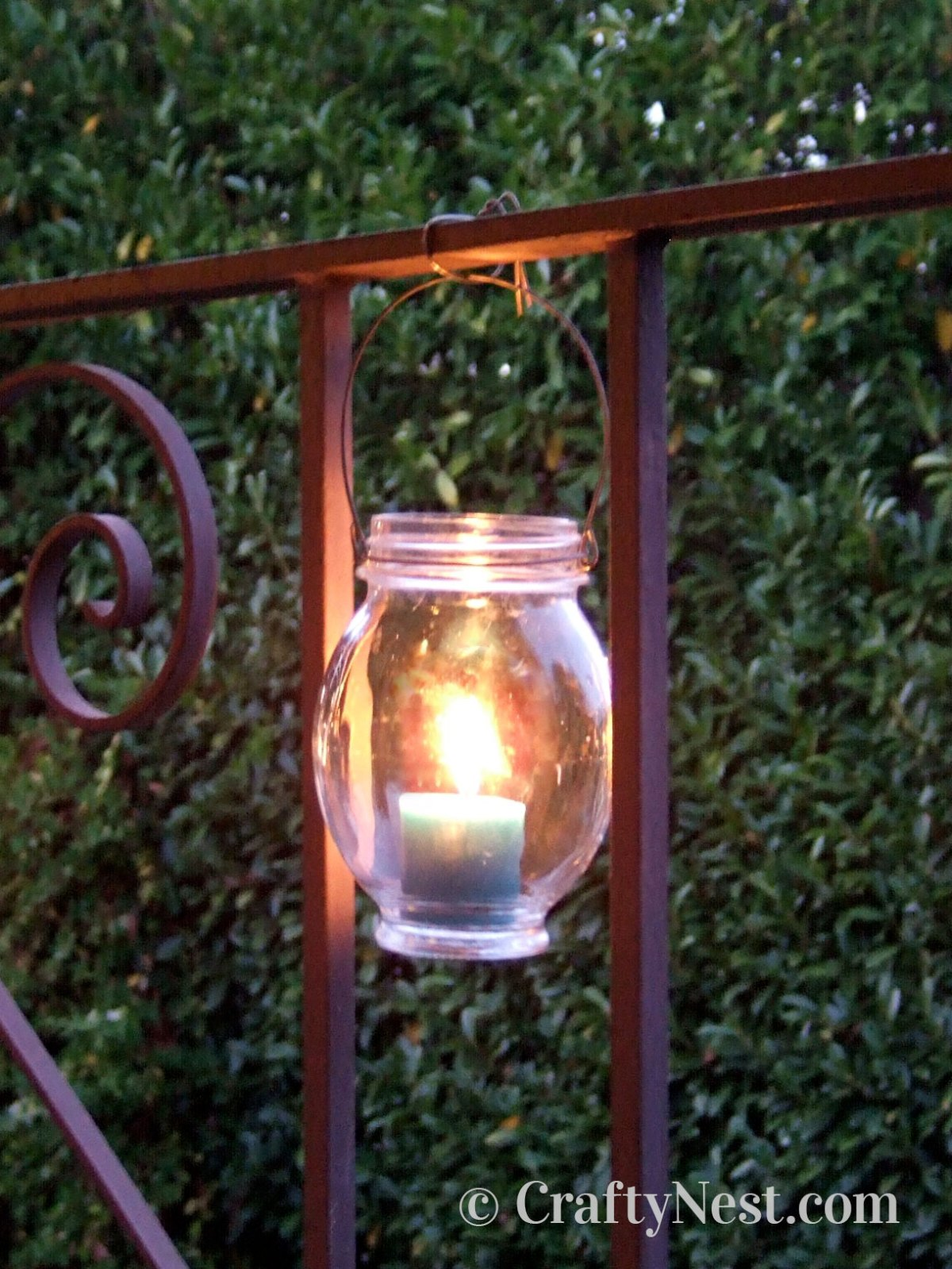 Hanging the jar from a railing with wire, photo