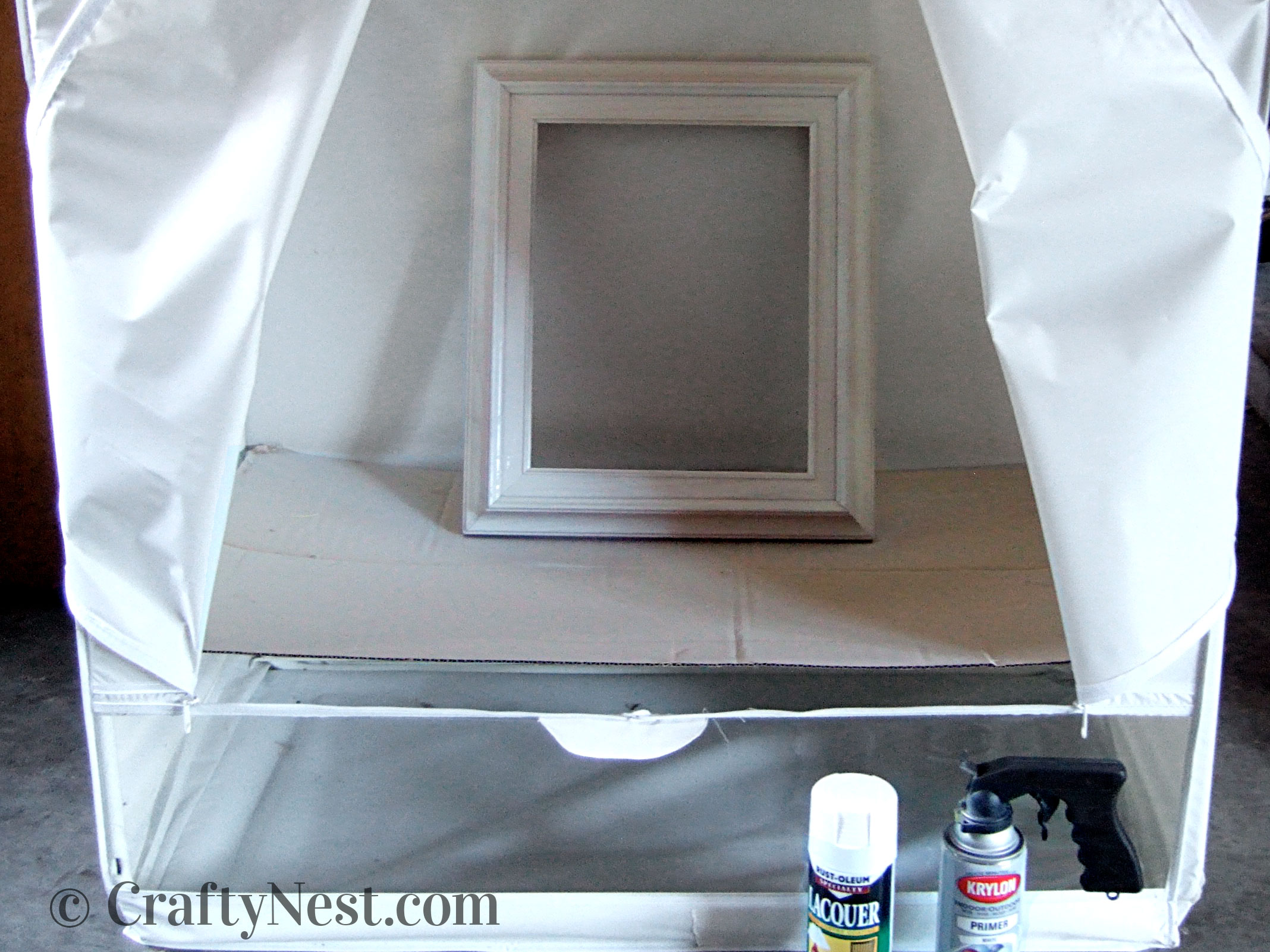 Spray-painting tent made from a plastic wardrobe, photo