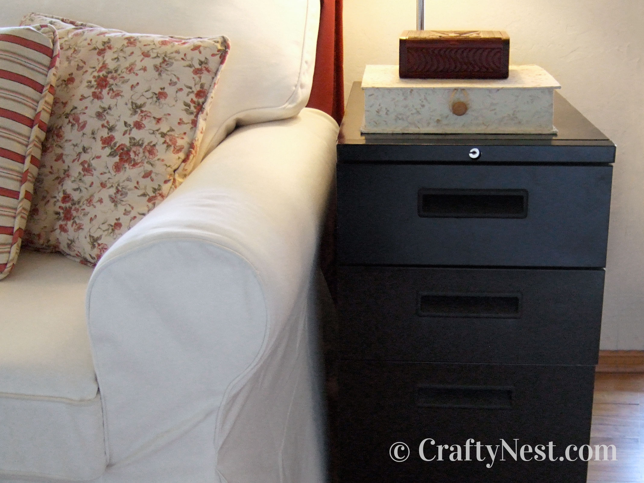 Black file cabinet used as an end table, photo