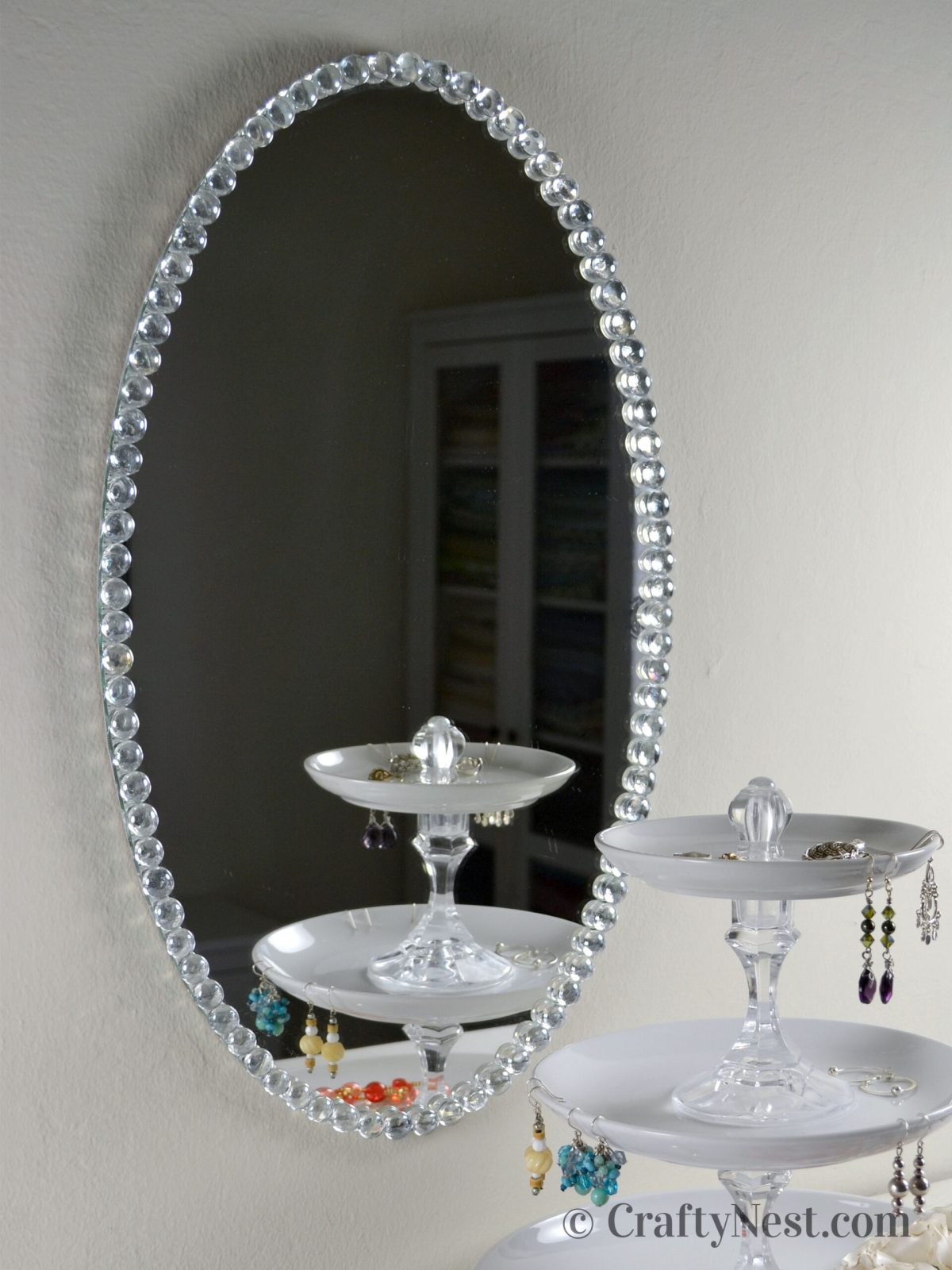 Oval beaded-glass-framed mirror, photo
