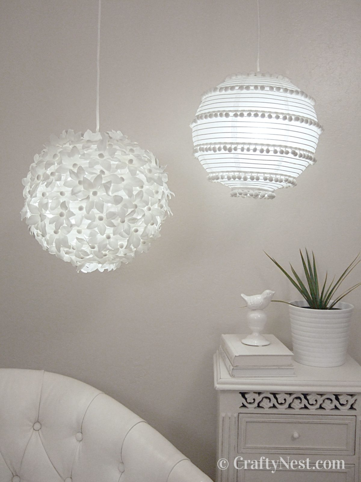 Two paper lanterns with flowers and pom poms, photo