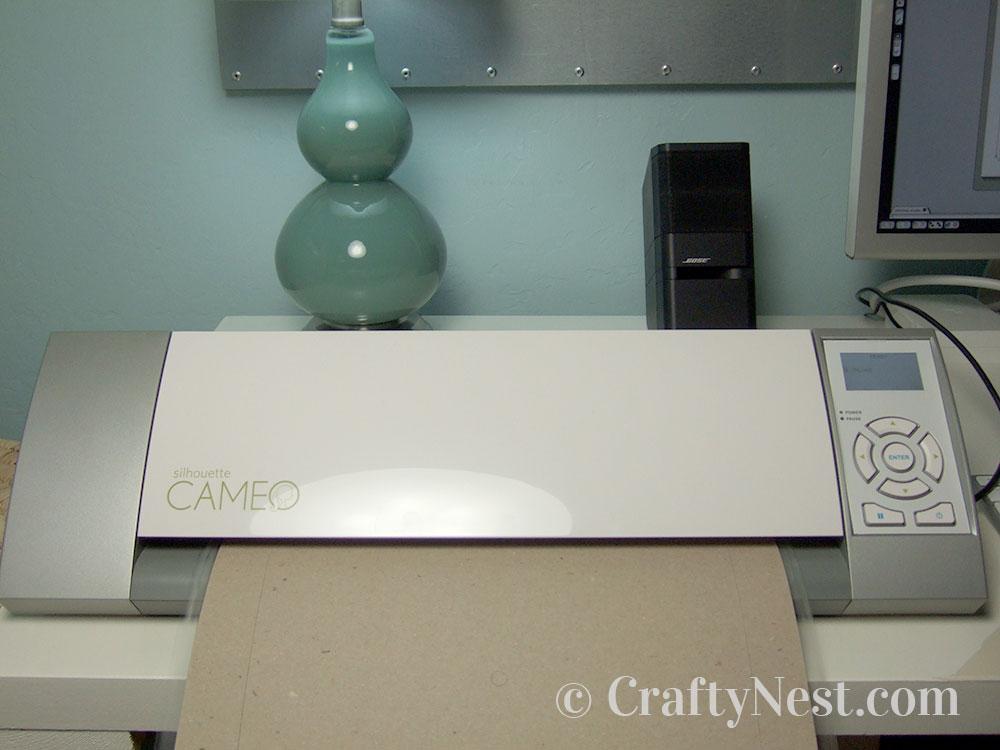 Cutting the cardboard in the Cameo, photo
