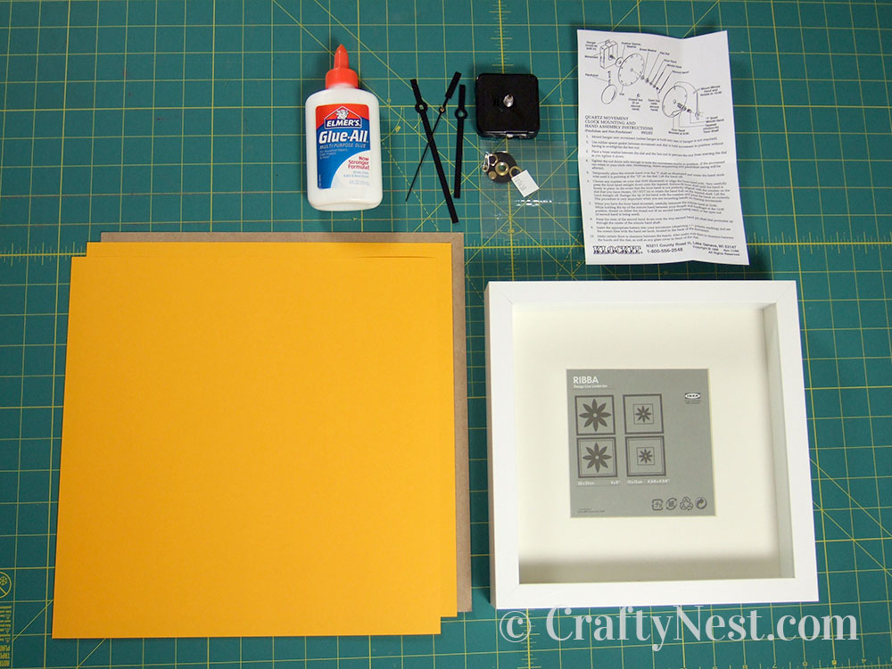 Supplies to make an embossed numbers clock, photo