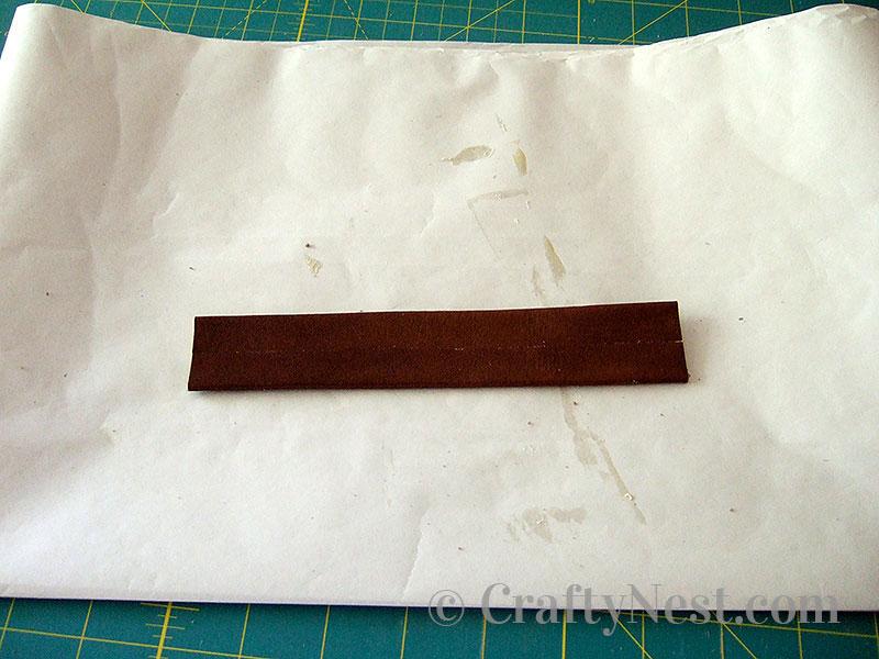 Fold glued sides together, photo