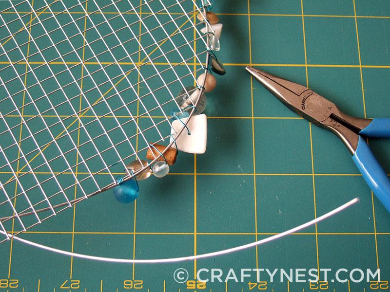 Keep stitching the beads, photo