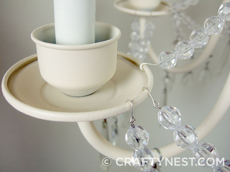 Strands connected to candle cup, photo