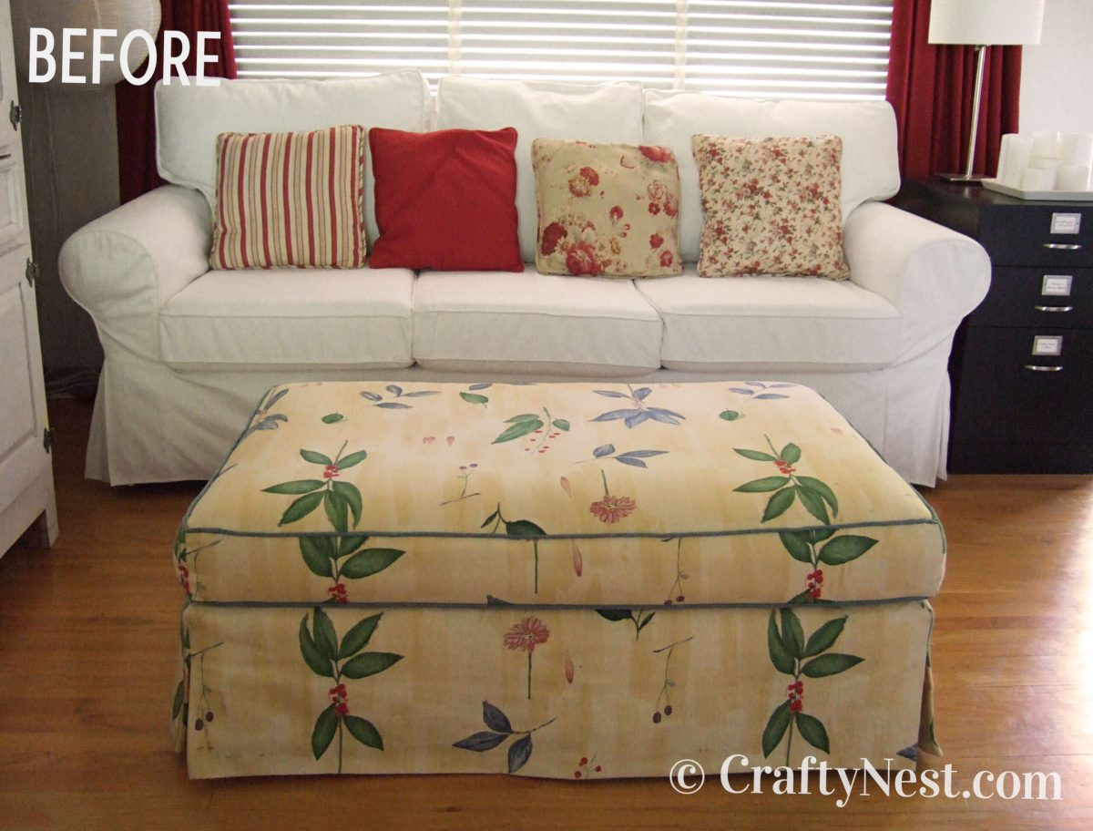 Old, flowered ottoman, before photo