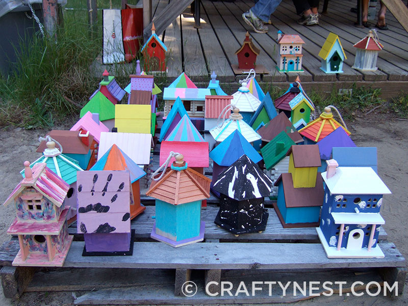 Colorful birdhouses on a pallet, photo