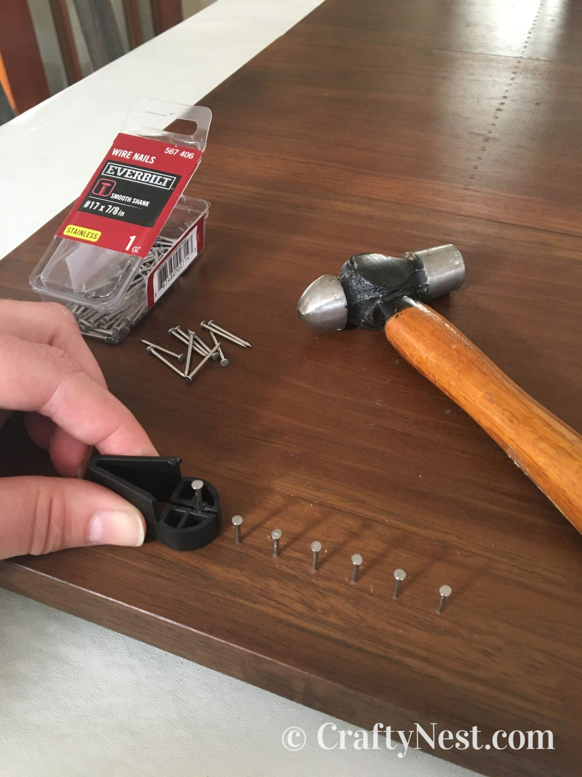 Hammering nails with nail holder, photo