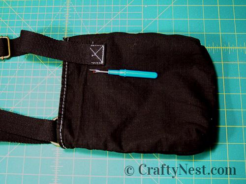 Remove the strap with a seam ripper, photo