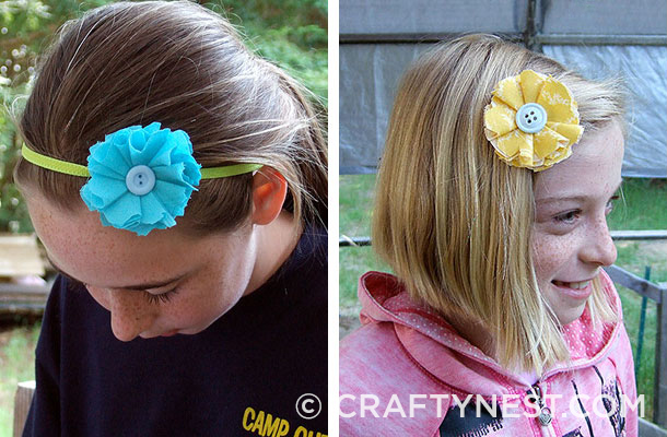 Two girls with fabric flower headbands in their hair, photo