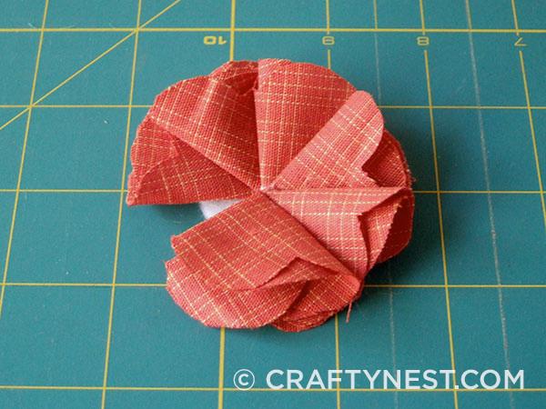 Fold and glue the sixth petal, photo