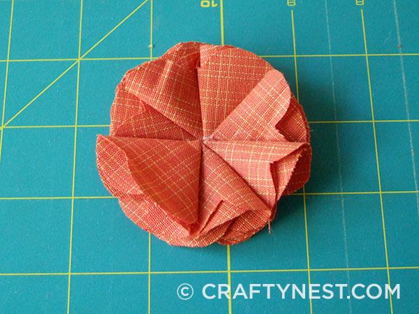 Fold and glue the seventh petal, photo