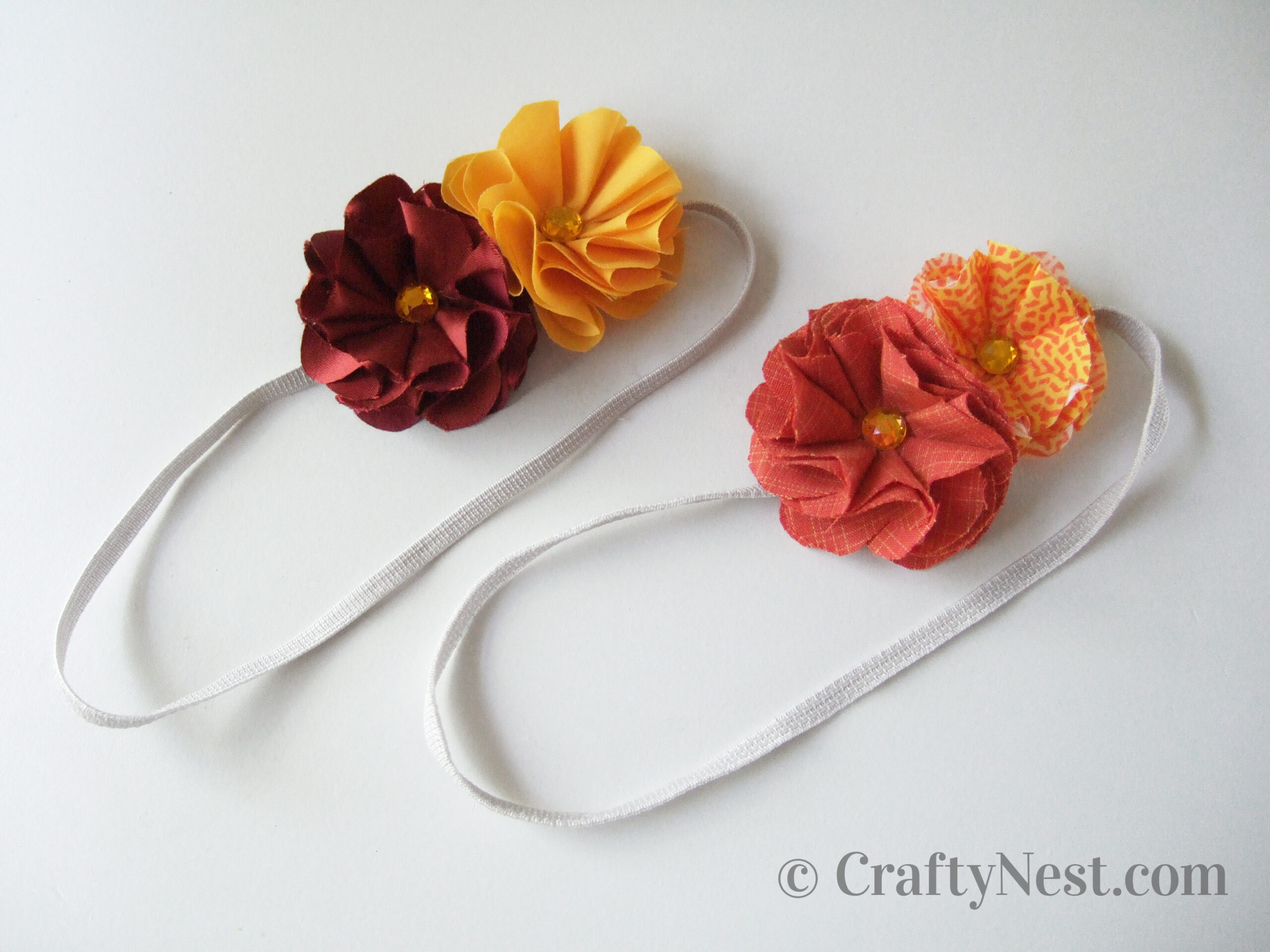 Two headbands with two fabric flowers each, photo