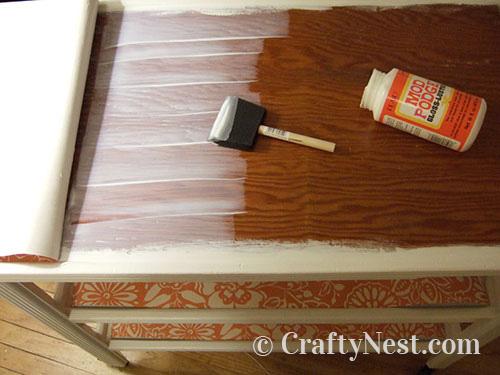Step 4, glue down the wallpaper, photo