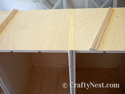 Apply glue where molding will go, photo