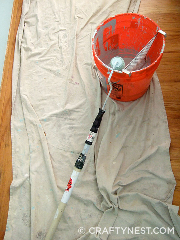5-gallon bucket and tools for painting, photo