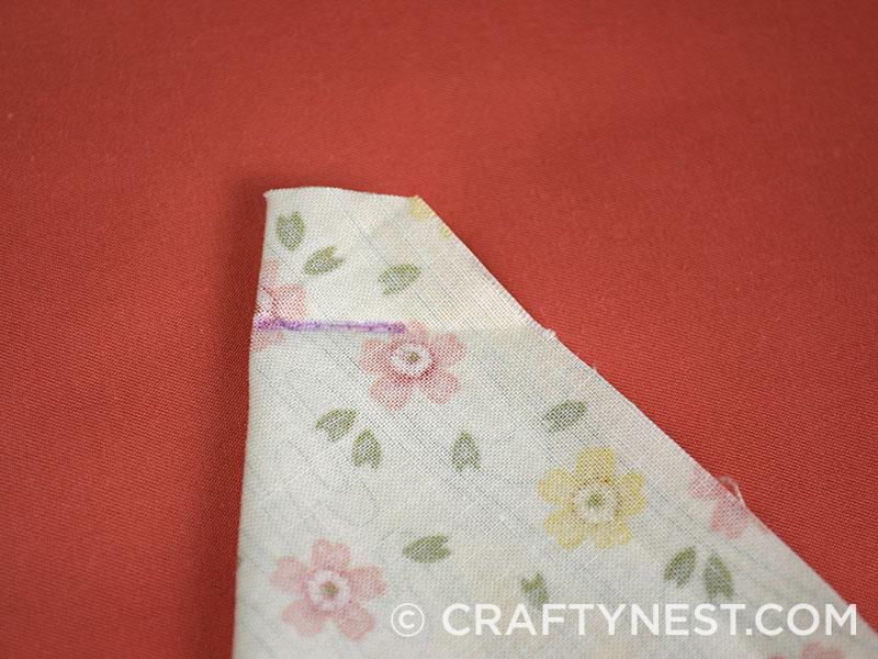 Fold the fabric diagonally, photo