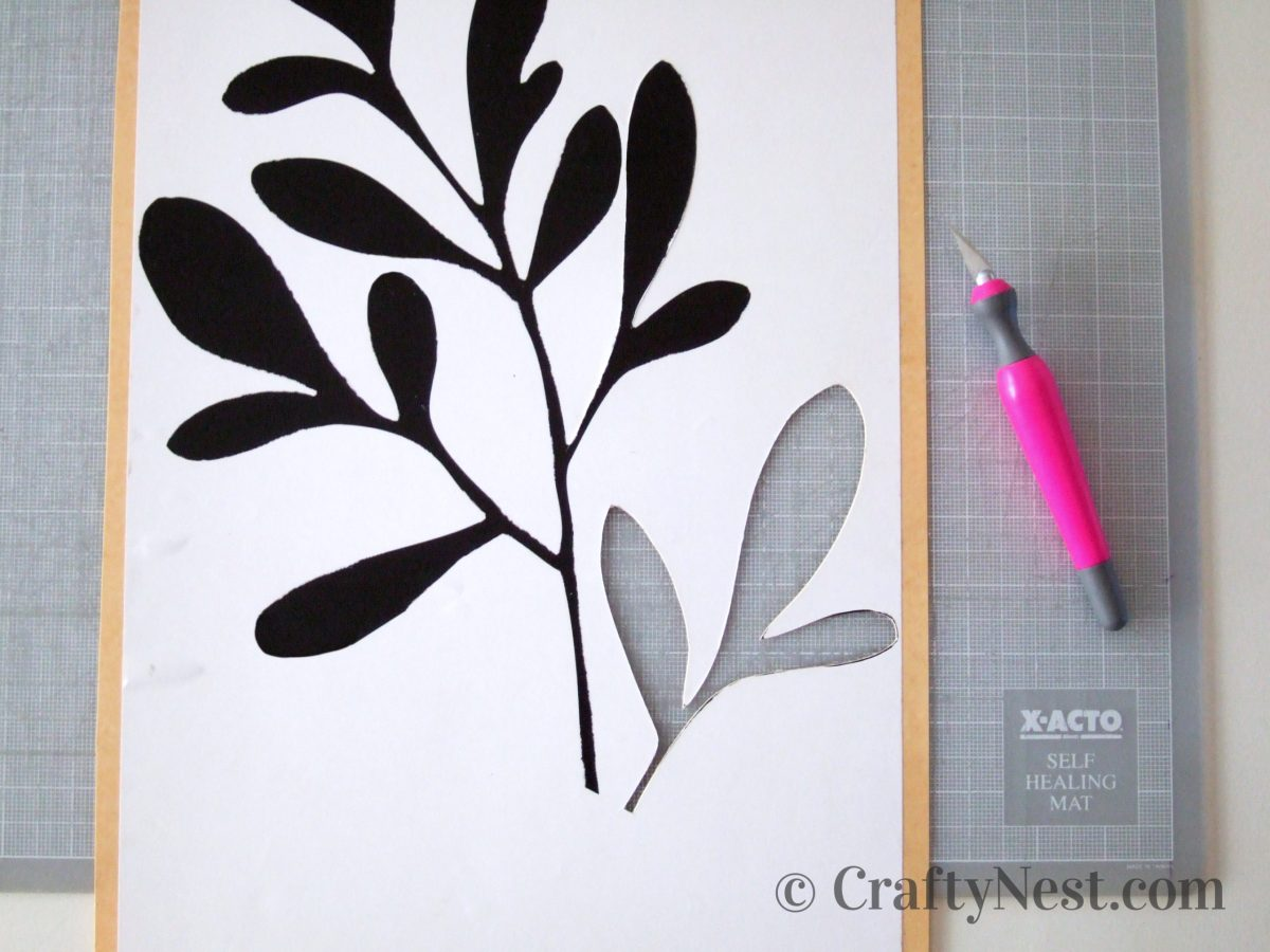 Cutting a stencil with an X-Acto knife, photo