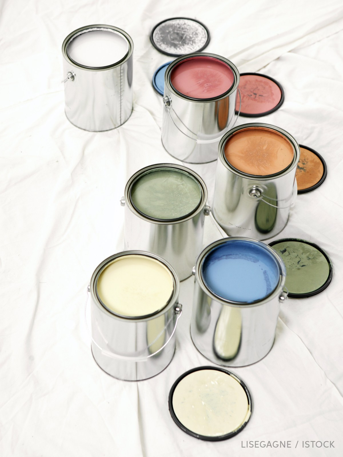 Open paint cans of differnt colors, photo
