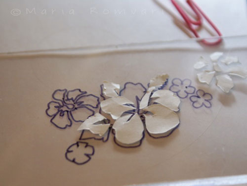 Cutting out the hibiscus flower pattern, photo