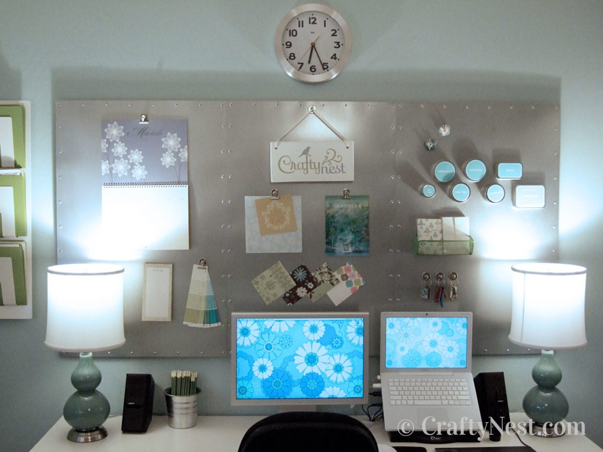 Large stainless steel magnet board above a desk, photo