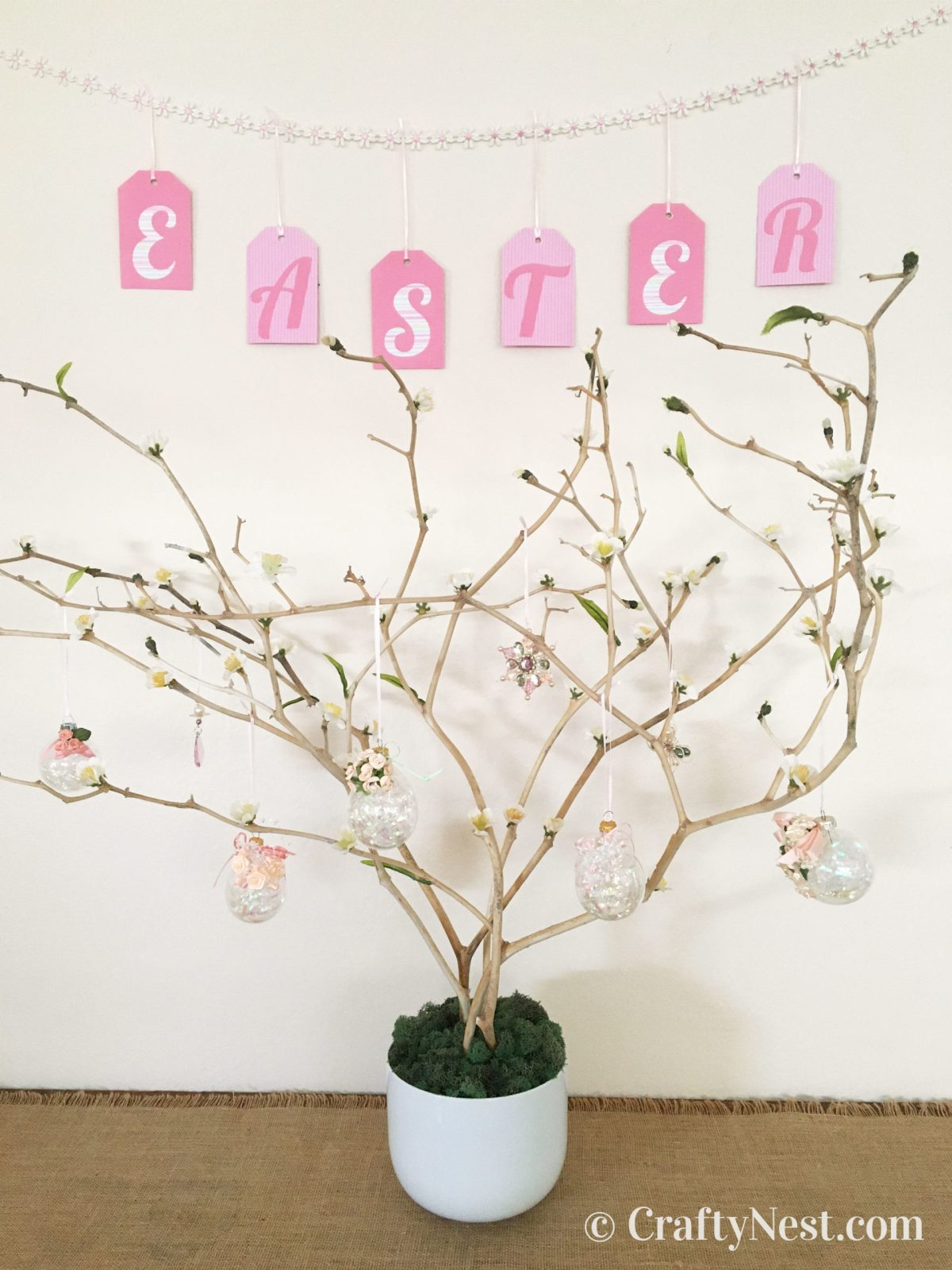 Easter tree in a pot with garland hanging above, photo