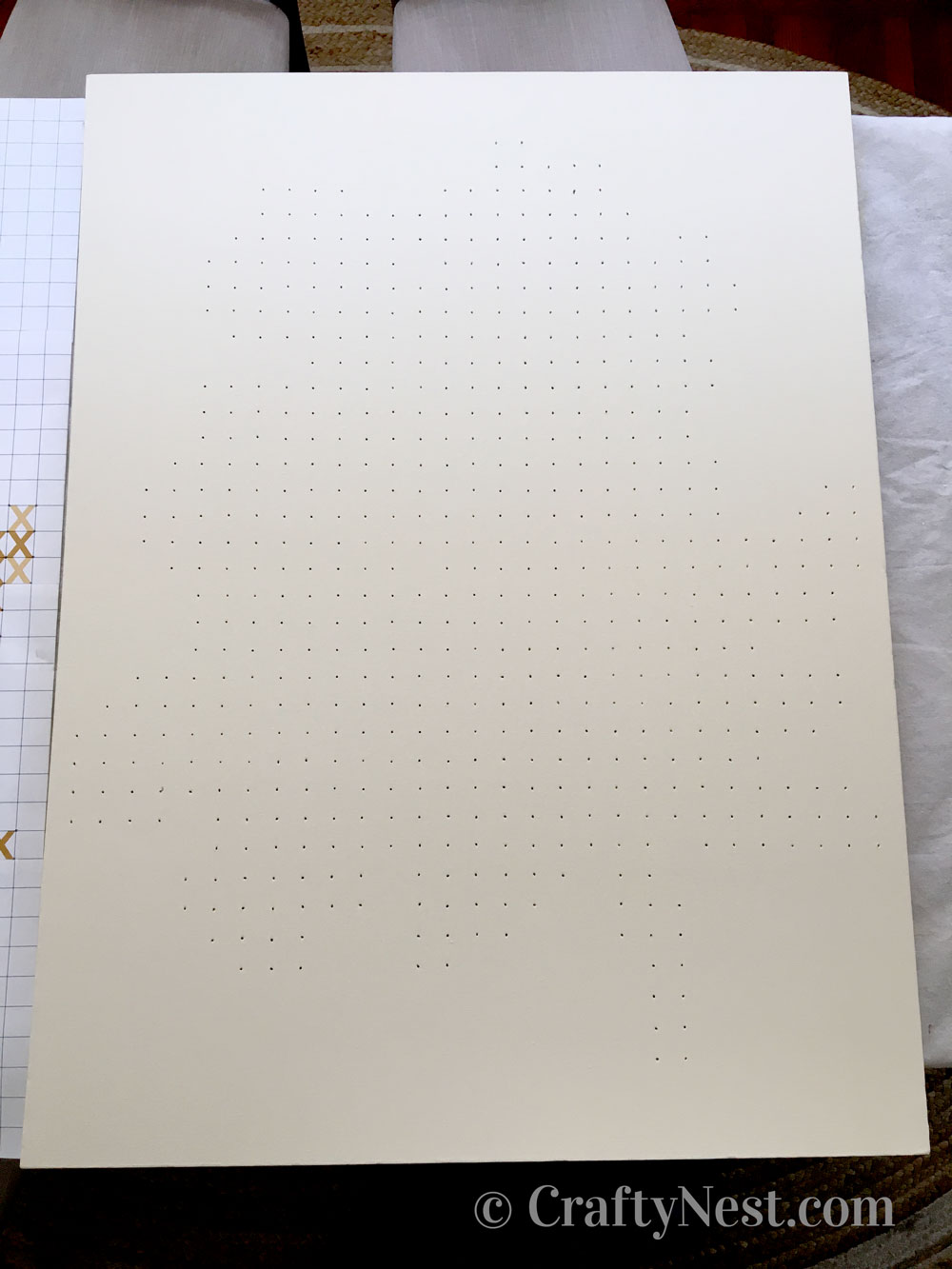 Blank painted canvas with holes, photo
