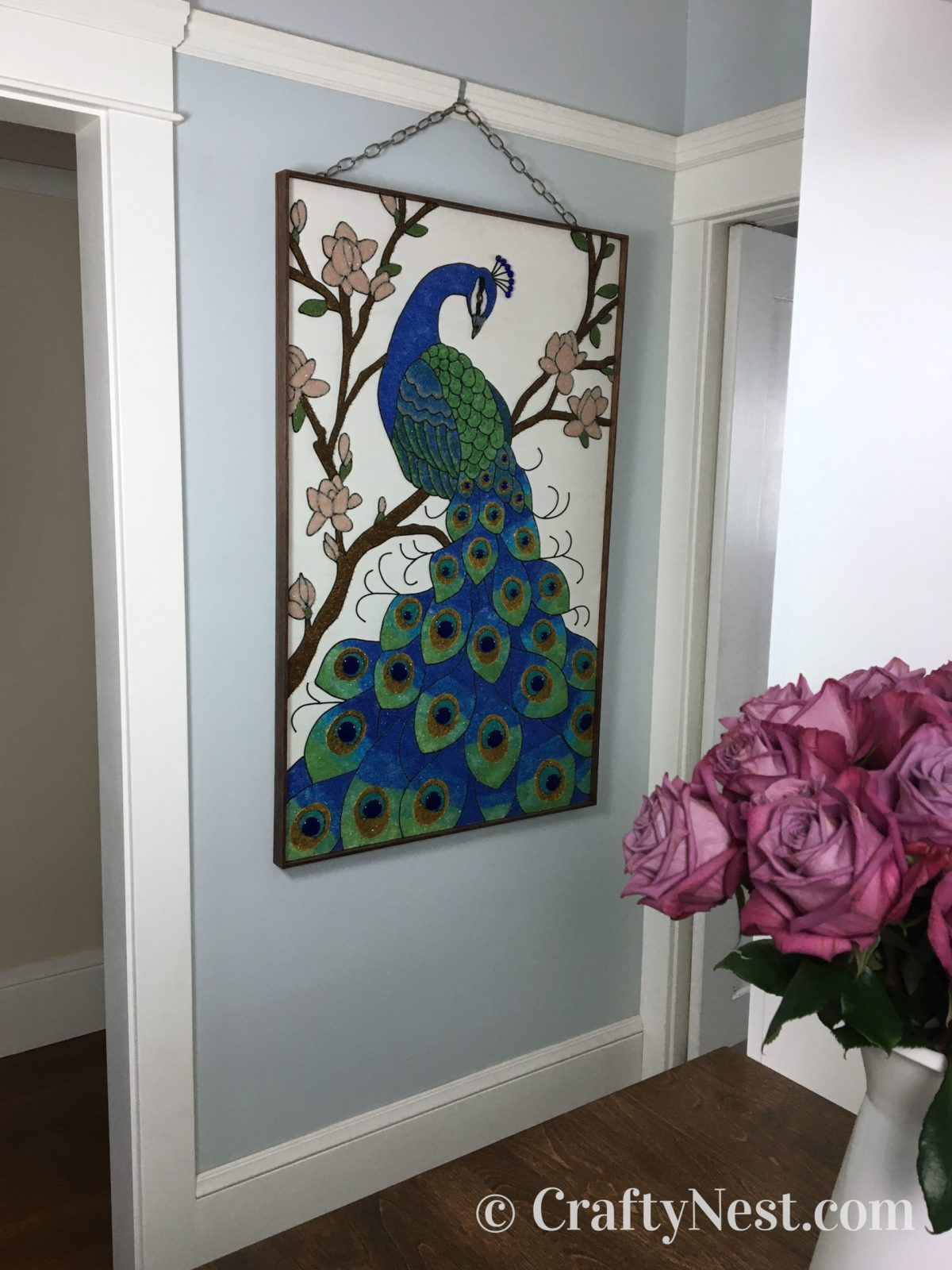 Peacock gravel art hanging on the wall, photo