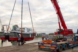 Lifting boat out of the river Lee
