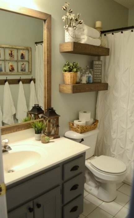 Organize a small bathroom with floating shelves over the toilet