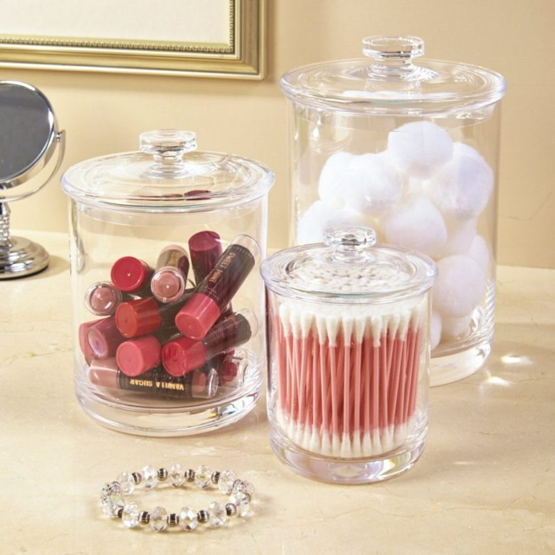 Organize a small bathroom with clear apothecary jars