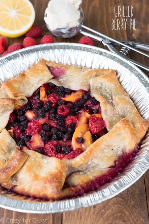 Learn how to grill a pie! This Grilled Berry Peach Pie Recipe is made on the BBQ for the perfect summer dessert!
