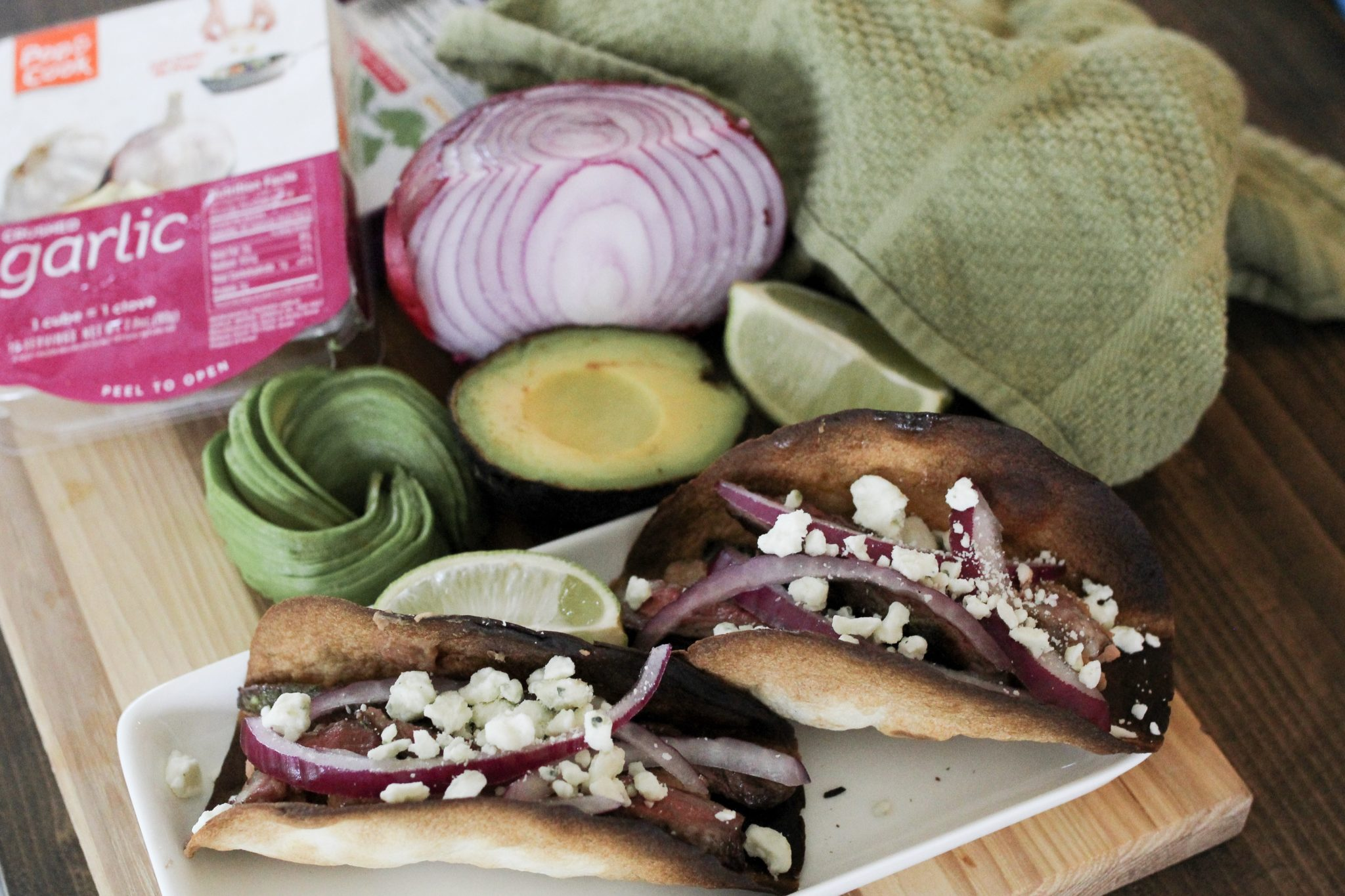 Easy Grilled Skirt Steak Tacos with a Garlic Cilantro Sauce. Grab Pop and Cook Crushed Garlic and Chopped Cilantro in the Frozen Vegetable aisle sold exclusively at Walmart.