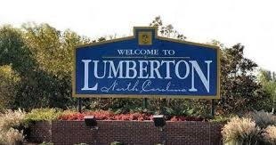 This image has an empty alt attribute; its file name is Lumberton-Sign.jpg