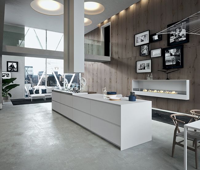 Cuisine moderne avec grand ilot central dans un loft