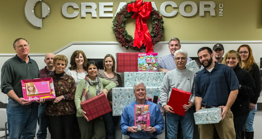 The Creatacor staff get the gifts ready for the Chamber Angels Program.