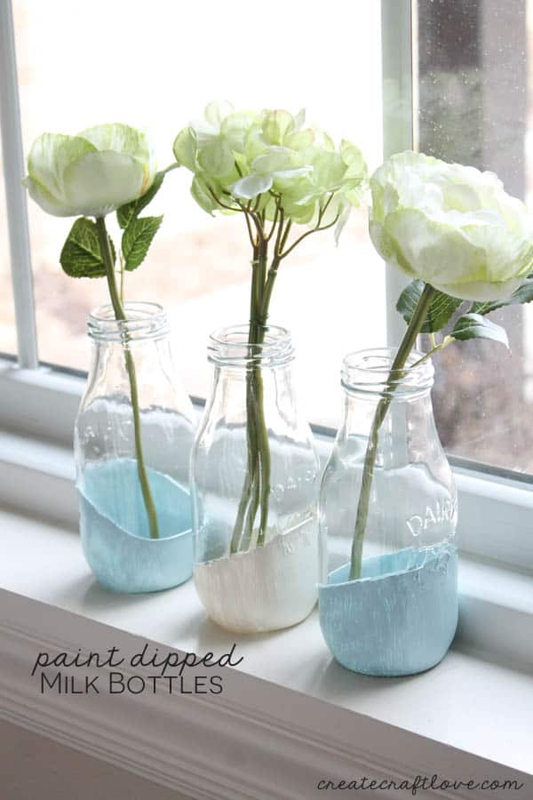 These Paint Dipped Milk Bottles makes beautiful bud vases for your fresh flowers! via createcraftlove.com