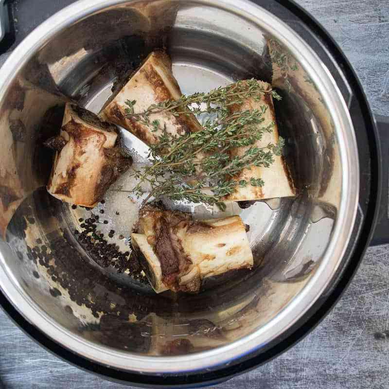 beef bones and herbs in instant pot