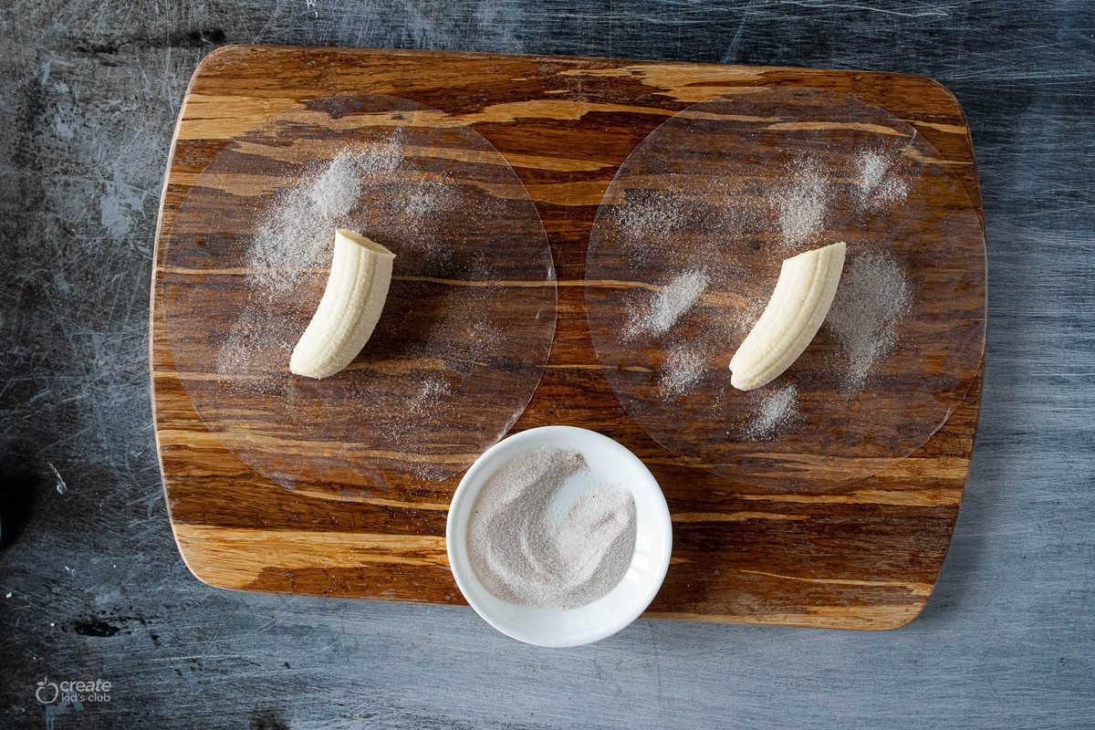 half a banana on a cinnamon sugar dusted spring roll