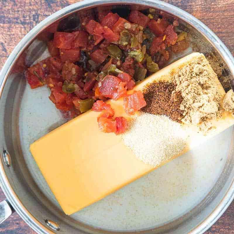 ingredients for velveta cheese sauce in pot