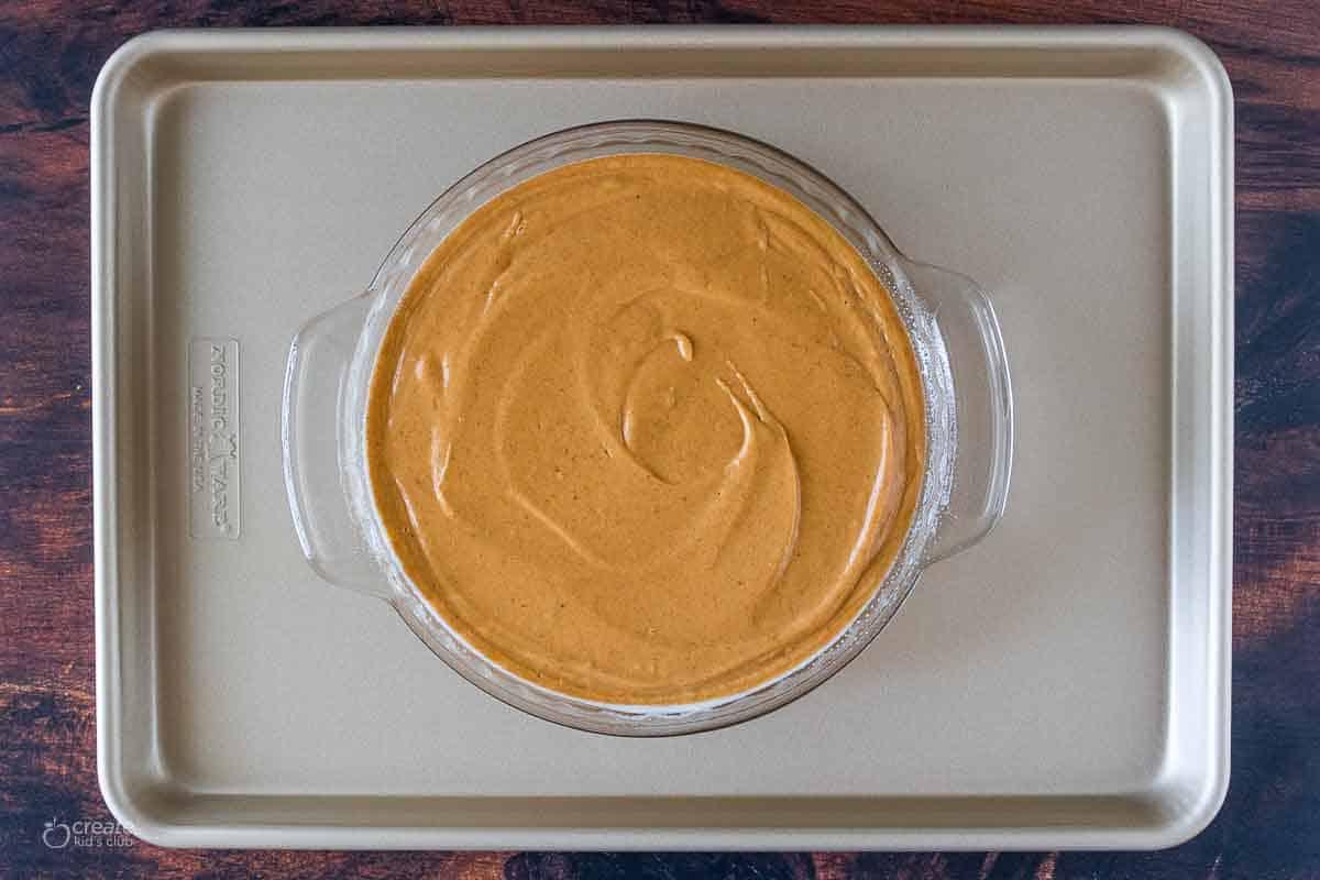 batter for pumpkin pie in pie pan