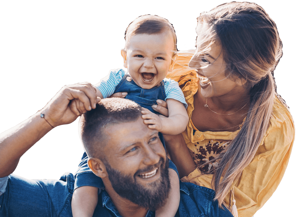 Happy family with a baby walking in the park