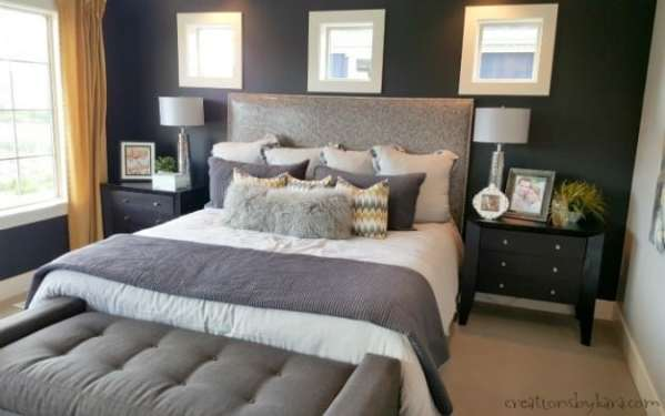 yellow and grey master bedroom Oakwood homes model home tour
