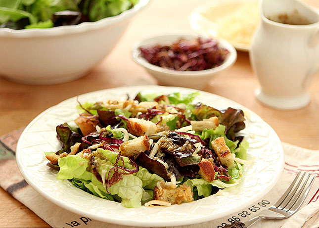 Mixed Greens Salad with Smoked Mozzarella and a Warm Roasted Garlic Dressing